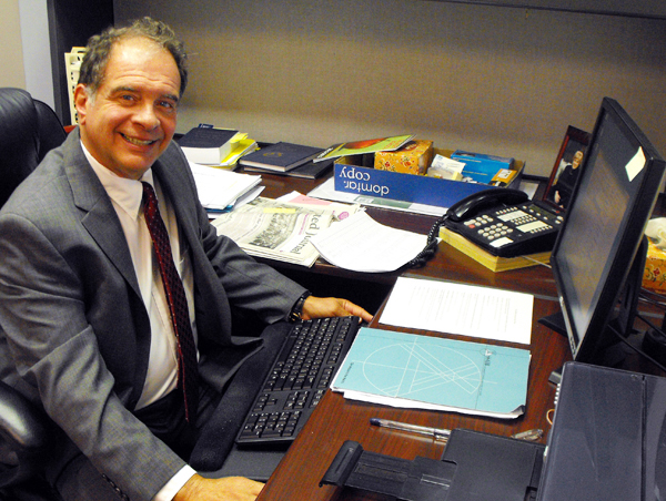Dr. Serio, Head of School, at his desk