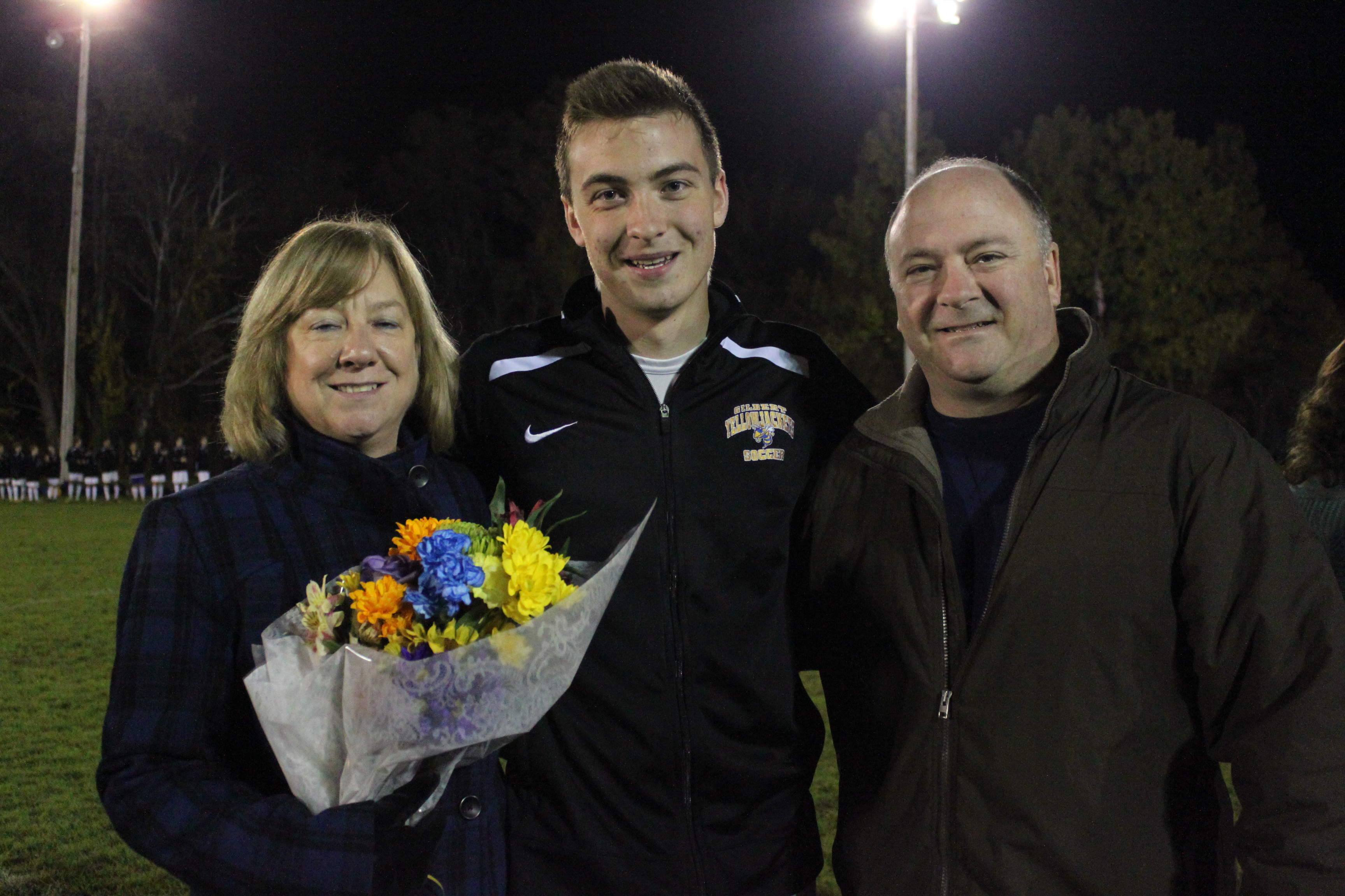 Parents with soccer player on Senior night 2014